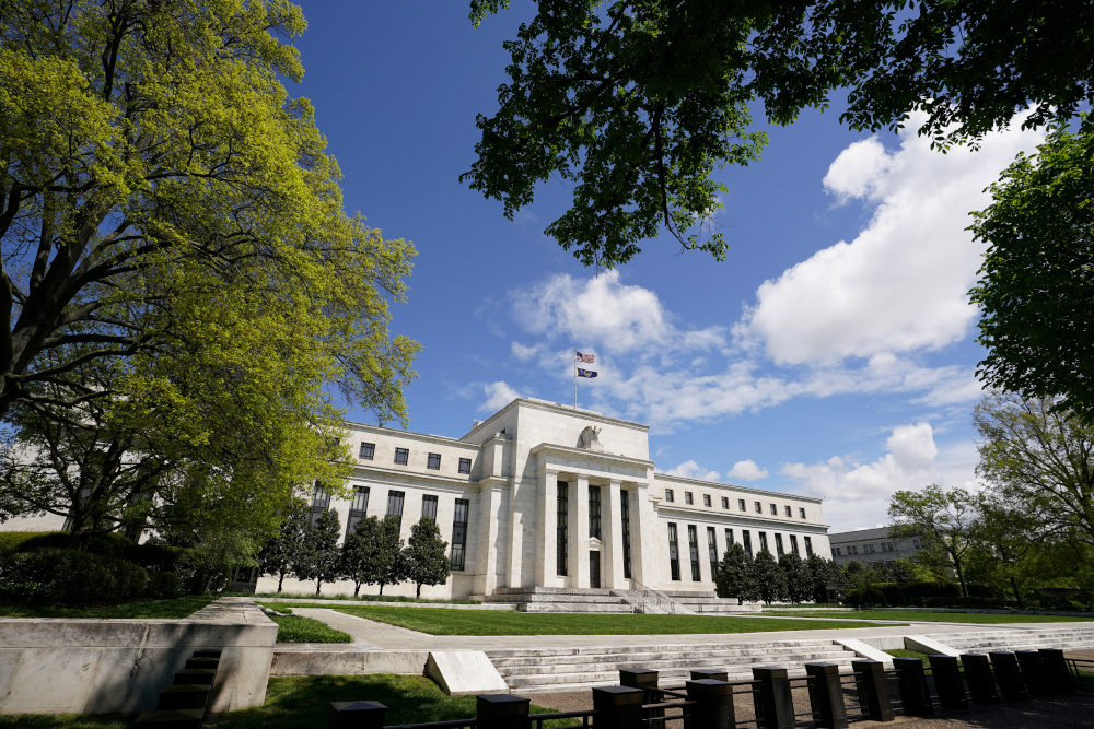 The Federal Reserve building is set against a blue sky in Washington, US, May 1, 2020. — Reuters pic