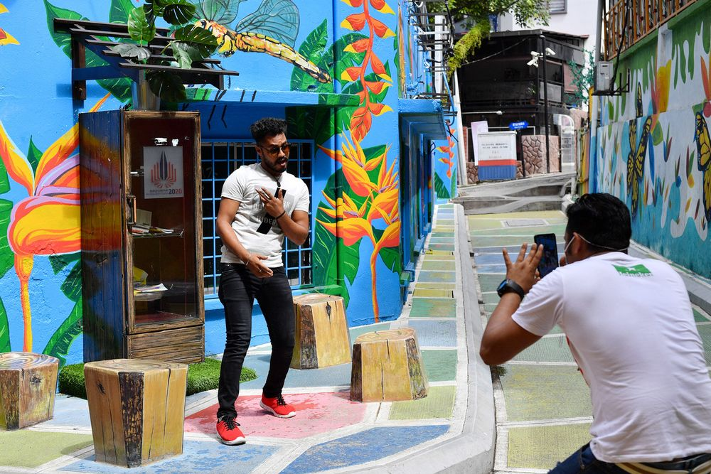 Local tourists snapping pictures at Jalan Alor mural lane, taking advantage of the quiet situation in the area following the imposition of the Conditional Movement Control Order, December 13, 2020. — Bernama pic