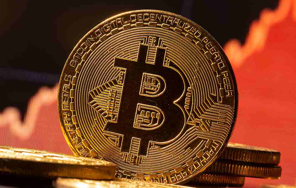 A representation of virtual currency Bitcoin is seen in front of a stock graph in this illustration taken November 19, 2020. — Reuters pic