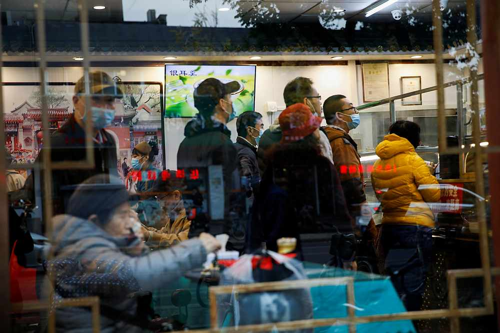People queue at a restaurant during lunch time amid the Covid-19 outbreak in Beijing, China November 16, 2020. — Reuters pic