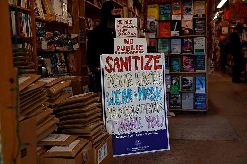 A safety protocol sign is seen at the entrance of Green Apple Books ahead of the new stay-at-home order in attempts to stem coronavirus spikes in San Francisco, California December 6, 2020. — Reuters pic