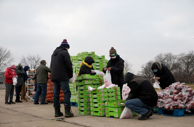 Volunteers from Forgotten Harvest food bank sort and separate different goods before a mobile pantry distribution ahead of Christmas, amid the Covid-19 pandemic in Warren, Michigan, US, December 21, 2020. — Reuters pic