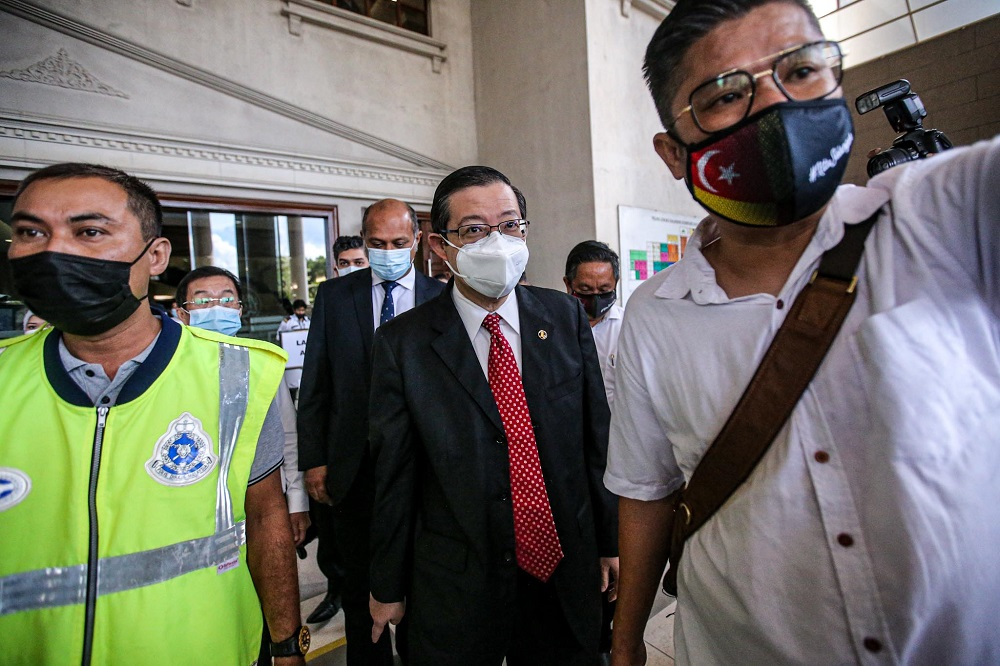 Lim Guan Eng (centre) is seen leaving the Kuala Lumpur High Court December 21, 2020. — Picture by Hari Anggara