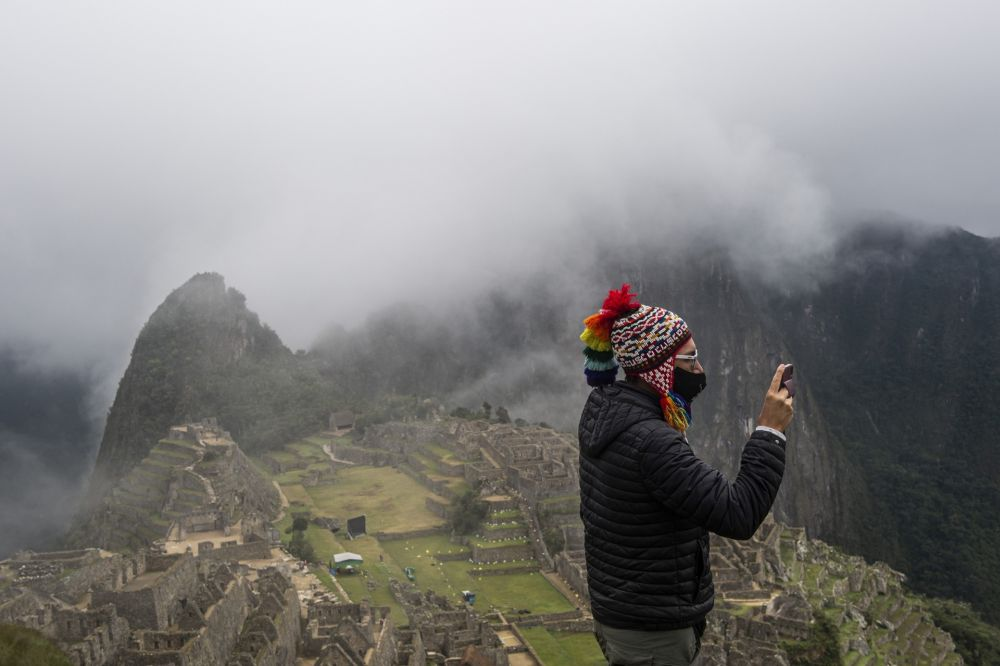 A tourist poses for a selfie in front of the archaeological site of Machu Picchu, in Cusco, Peru. — AFP pic