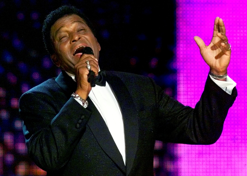 Country music legend Charley Pride performs a medley of his music at the 34th annual Country Music Association Awards show at the Grand Ole Opry House in Nashville, Tennessee October 4, 2000. — Reuters pic