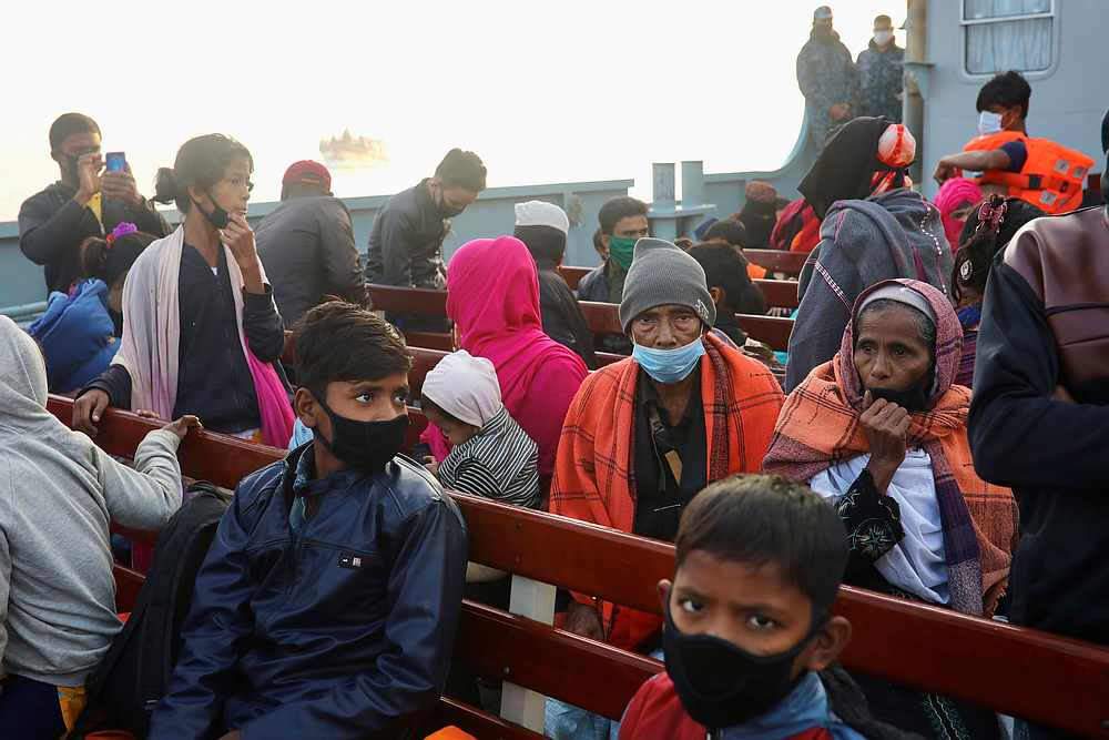 Rohingyas refugees sit on board a navy ship to move to Bhasan Char island in Chattogram, Bangladesh December 29, 2020. — Reuters pic