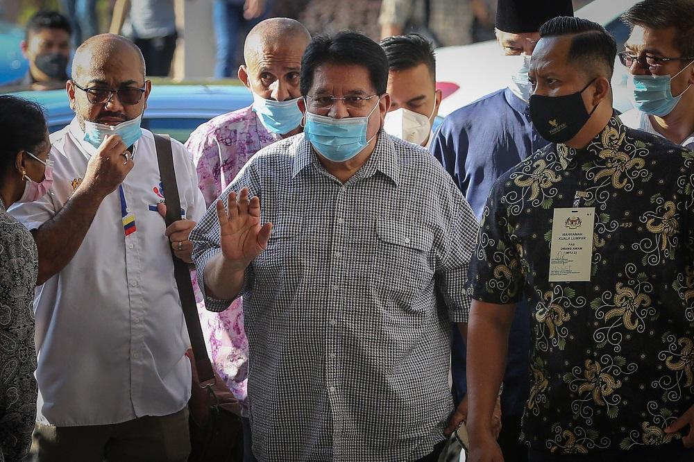 Former Federal Territories minister Datuk Seri Tengku Adnan Tengku Mansor arrives at the Kuala Lumpur Court Complex December 21, 2020. ― Picture by Yusof Mat Isa