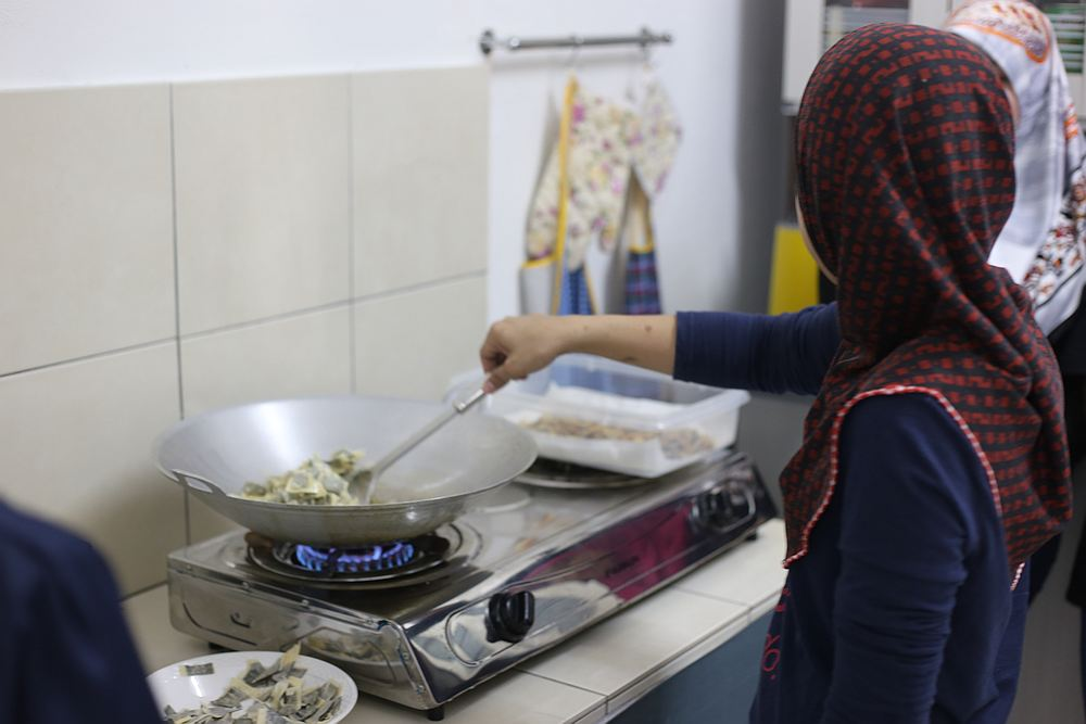Ros says she enjoys cooking with the other beneficiaries at TKTN. — Picture courtesy of Malaysian AIDS Foundation
