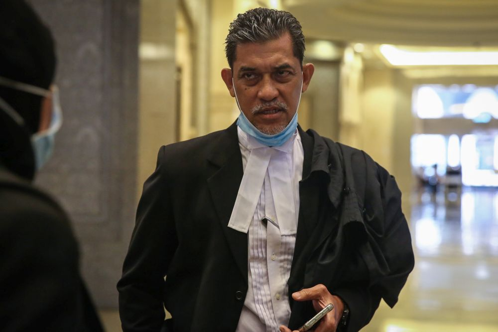 Lawyer Abdul Rahim Sinwan speaks to reporters at the Federal Court in Putrajaya December 14, 2020. — Picture by Yusof Mat Isa