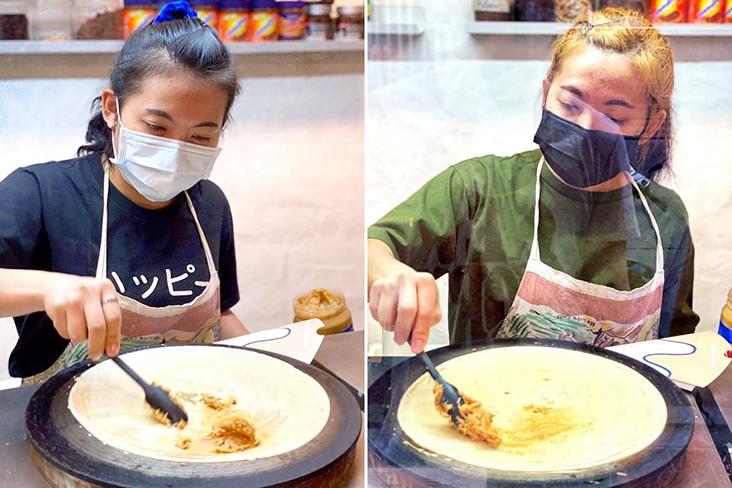 A Thai 'crêpière' making fresh crêpes to order.