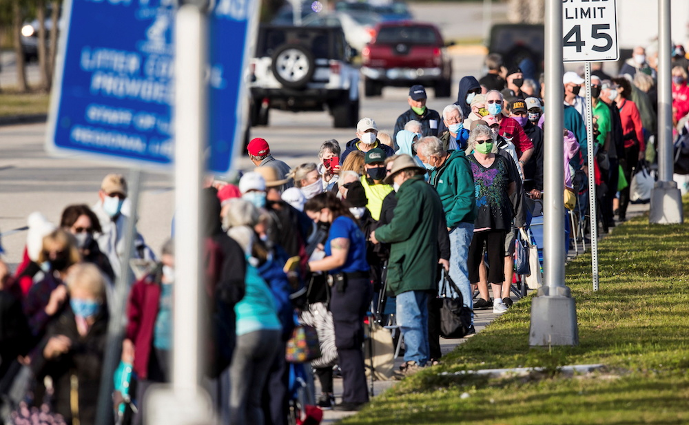 Hundreds wait in line at Lakes Park Regional Library to receive the Covid-19 vaccine in Fort Myers, Florida December 30, 2020. — Andrew West/The News-Press/USA Today Network via Reuters