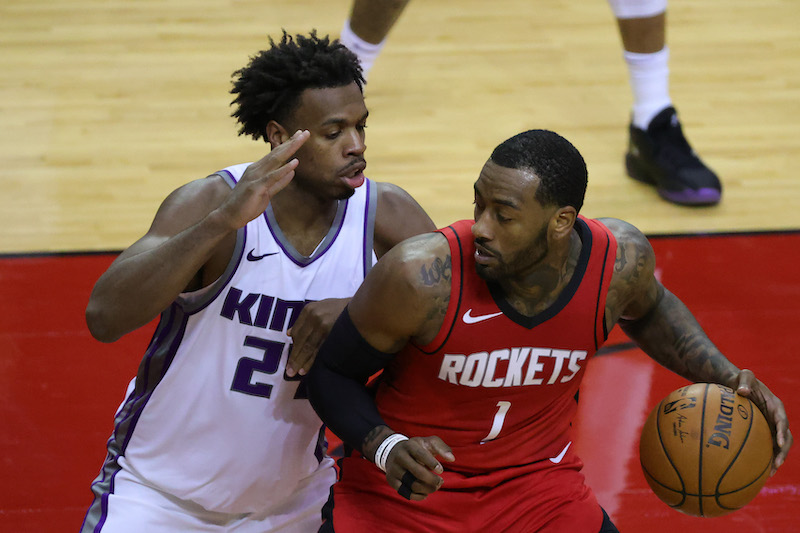 John Wall of the Houston Rockets controls the ball against Buddy Hield of the Sacramento Kings at Toyota Center in Houston, Texas January 2, 2021. — Carmen Mandato/Pool Photo-USA TODAY Sports pic via Reuters