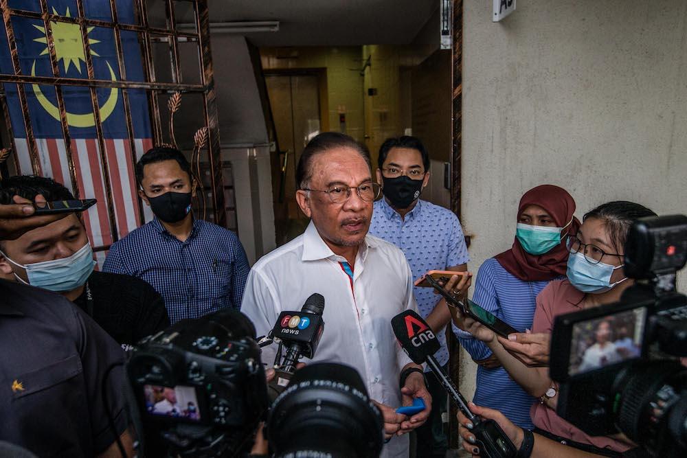 PKR president Datuk Seri Anwar Ibrahim speaks to reporters after meeting with the Pakatan Harapan presidential council in Petaling Jaya January 12, 2021. — Picture by Firdaus Latif
