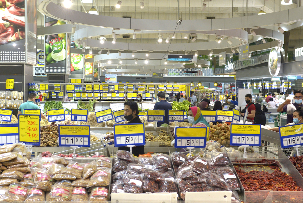 People shop for groceries at a supermarket in Subang Jaya a day before the movement control order (MCO) takes effect, January 12,2021. — Picture by Miera Zulyana