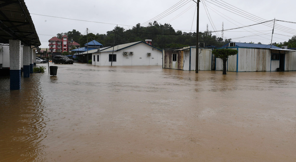 The Penampang Police Station is flooded after continuous heavy rain in the area, January 17, 2021. — Bernama pic