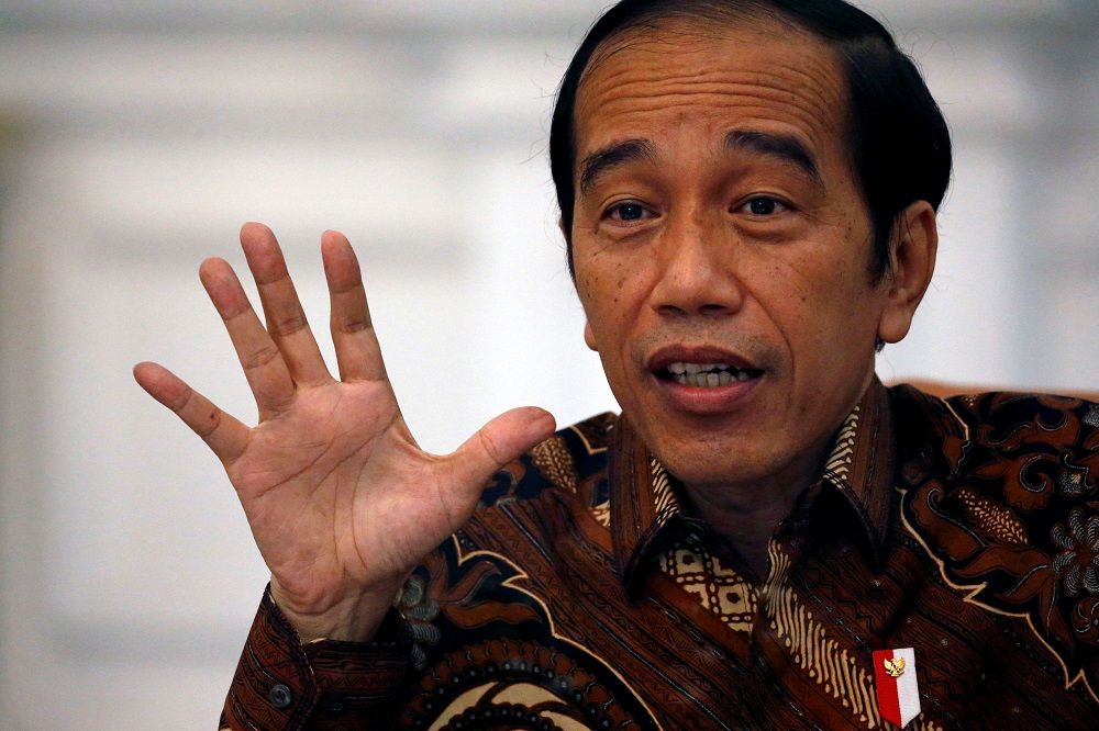 Indonesian President Joko Widodo gestures during an interview with Reuters at the presidential palace in Jakarta November 13, 2020. — Reuters pic