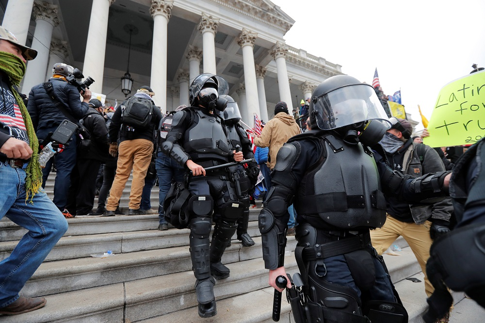 Federal prosecutors allege Klein assaulted police officers with a riot shield and jammed it into doors at the Capitol. — Reuters pic