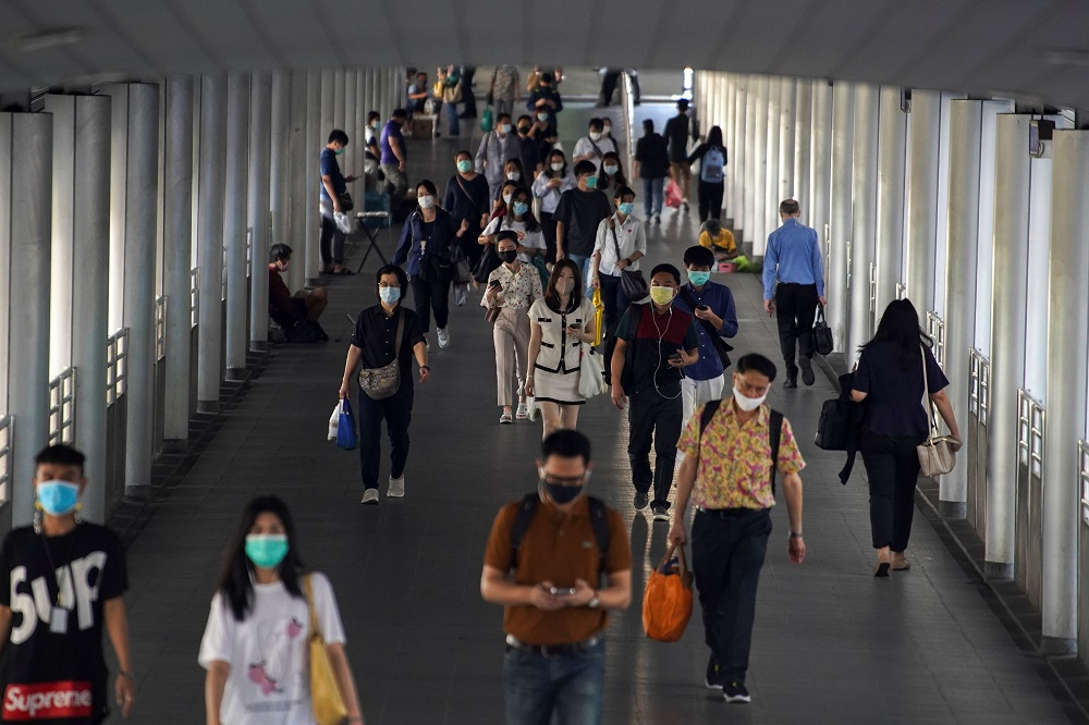People wearing face masks as a measure to prevent the spread of the coronavirus disease are seen at a train station in Bangkok January 7, 2021. — Reuters pic