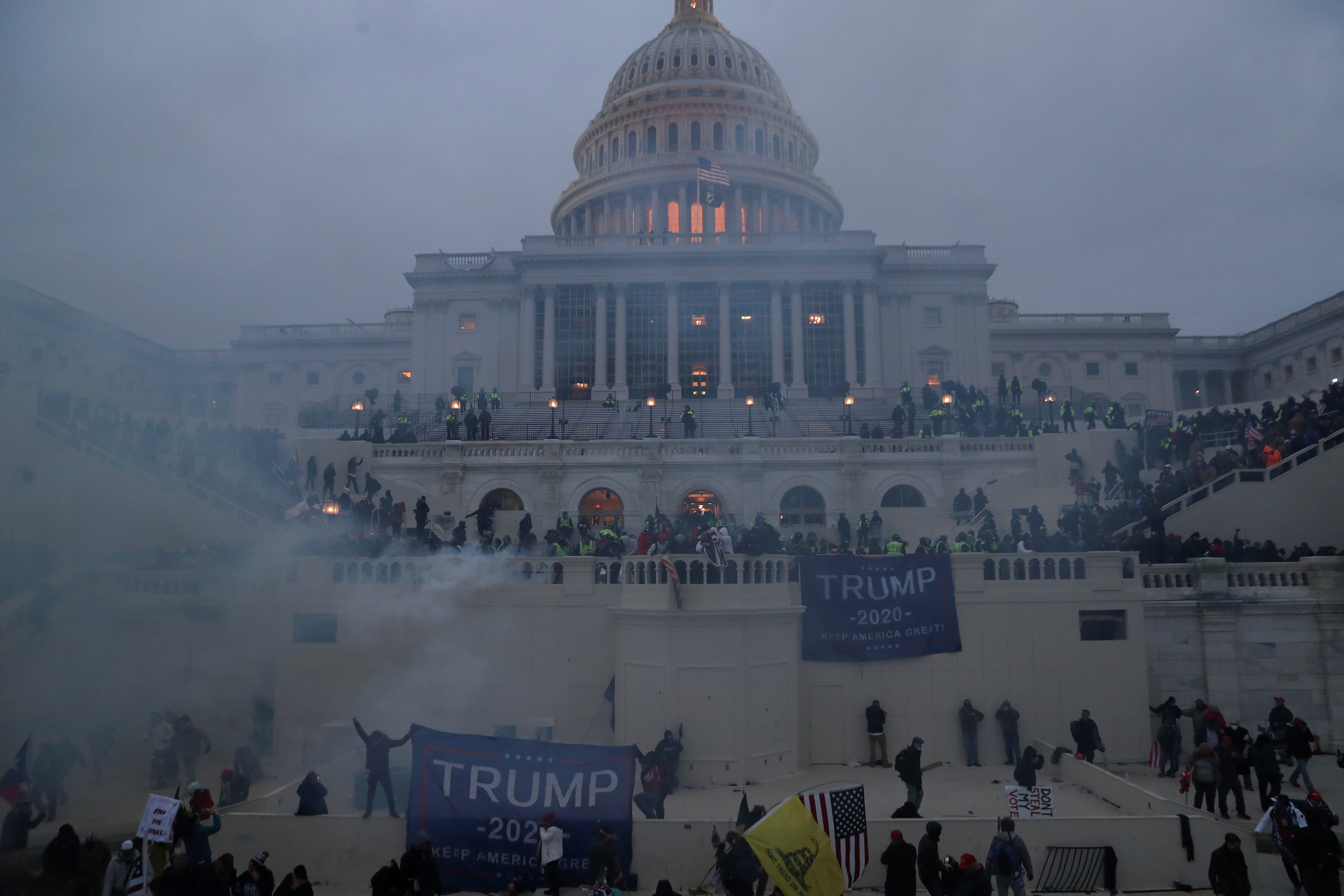 Police officers stand guard as supporters of US President Donald Trump gather in front of the US Capitol Building in Washington January 6, 2021. — Reuters pic