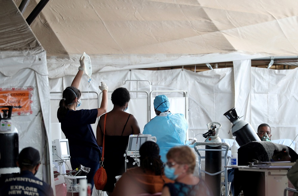 Health workers attend to patients in tents at the parking lot of the Steve Biko Academic Hospital, amid a nationwide coronavirus disease lockdown, in Pretoria, South Africa January 11, 2021. — Reuters pic
