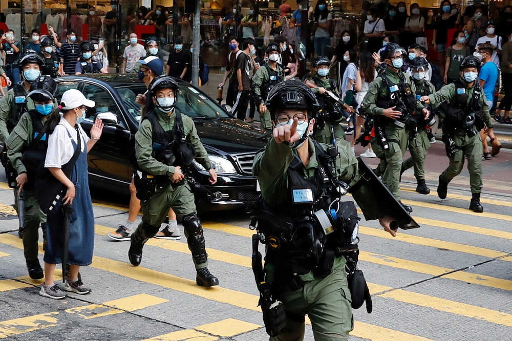 Riot police chase pro-democracy protesters during a demonstration opposing postponed elections, in Hong Kong September 6, 2020. — Reuters pic