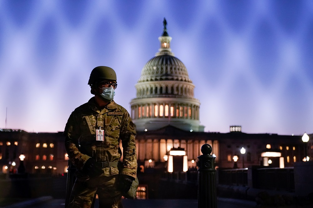 Members of the National Guard gather at the US Capitol in Washington January 12, 2021. — Reuters pic