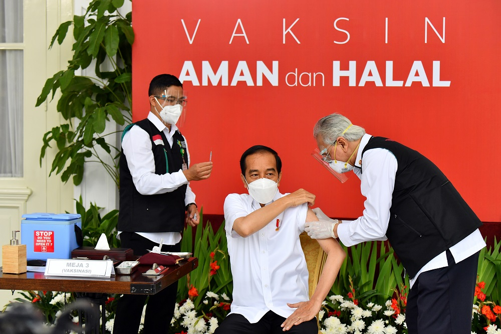 Indonesian President Joko Widodo receives a shot of Covid-19 vaccine at the Merdeka Palace in Jakarta January 13, 2021. — Picture courtesy of Agus Suparto/Indonesian Presidential Palace/Handout via Reuters