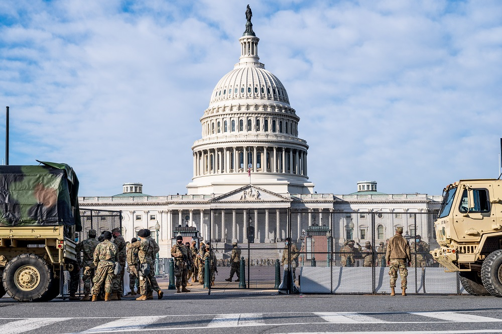 National Guard troops standing guard by non-scalable fencing that was recently installed around the Capitol in Washington January 13, 2021. — Picture by Michael Brochstein/Sipa USA via Reuters