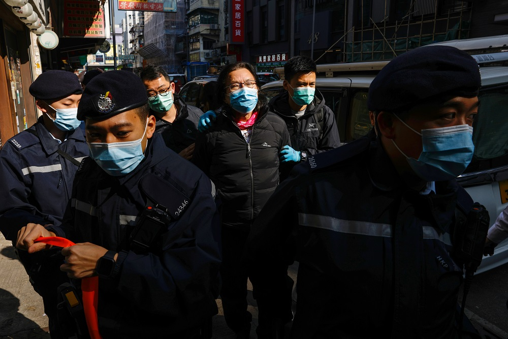 Daniel Wong Kwok-tung, a lawyer who tried to help the 12 people detained in mainland China, is escorted by police as he returns to his office in Hong Kong January 14, 2021. — Reuters pic