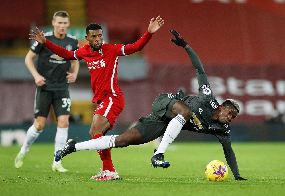 Manchester United's Paul Pogba in action with Liverpool's Georginio Wijnaldum during the match at Anfield in Liverpool January 17, 2021. — Pool pic via Reuters