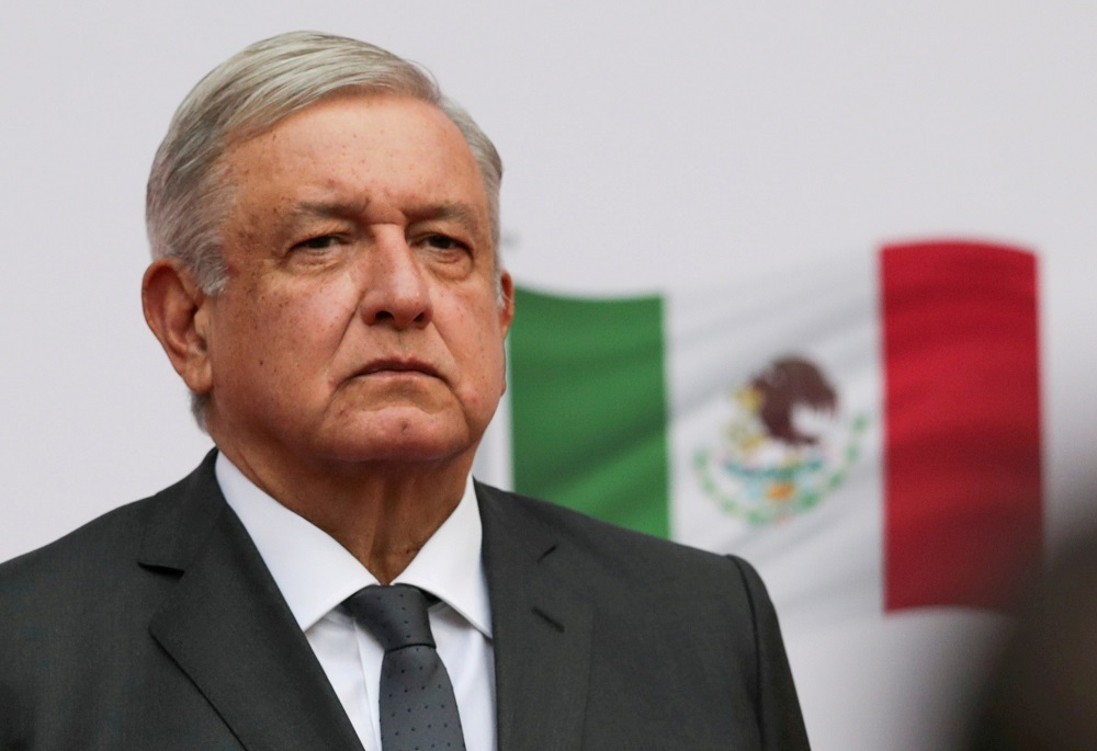 Mexico's President Andres Manuel Lopez Obrador listens to the national anthem as he arrives to address the nation on his second anniversary as President of Mexico, at the National Palace in Mexico City December 1, 2020. — Reuters pic