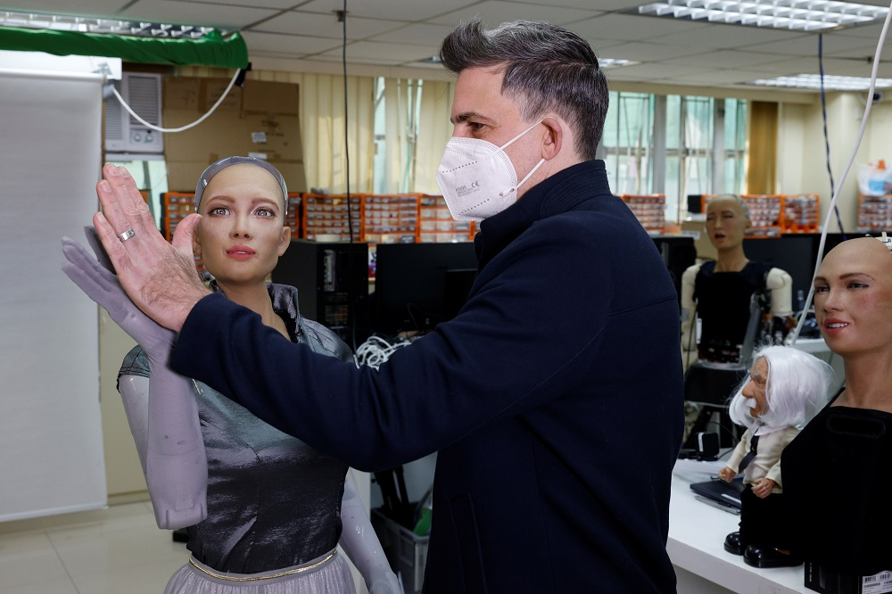 An engineer adjusts the cover at the back of humanoid robot Sophia's head developed by Hanson Robotics at the company's lab in Hong Kong January 12, 2021. — Reuters pic