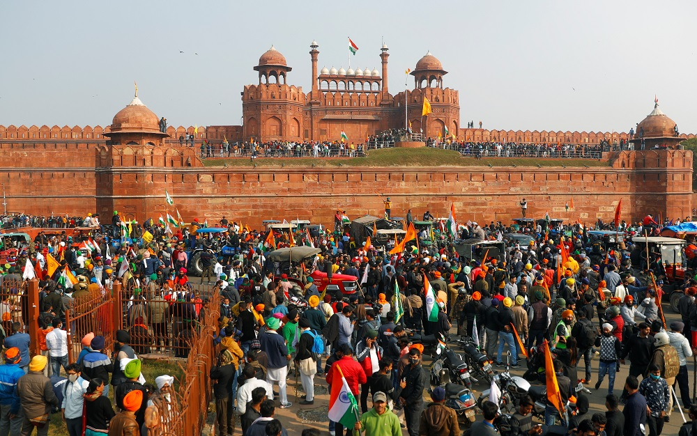 Farmers gather in front of the historic Red Fort during a protest against farm laws introduced by the government, in Delhi January 26, 2021. — Reuters pic