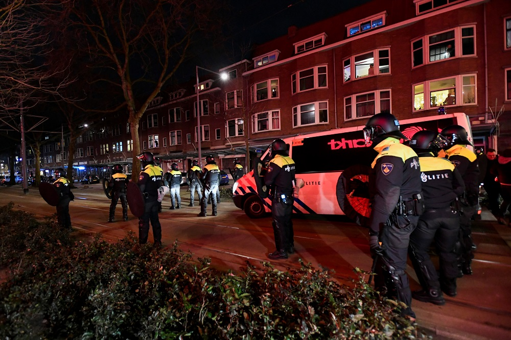 Police officers block a street during a demonstration against restrictions put in place to curb the spread of the coronavirus disease in Rotterdam January 26, 2021. — Reuters pic