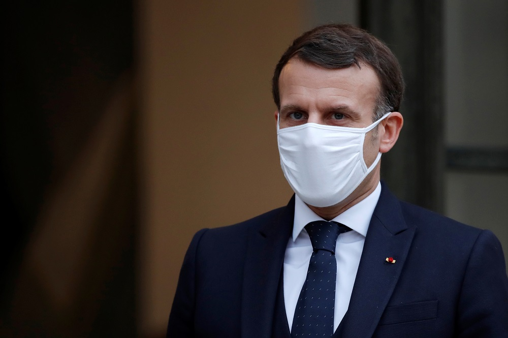 French President Emmanuel Macron, wearing a protective face mask, accompanies Interim Malian President Bah Ndaw (not seen) after a meeting at the Elysee Palace in Paris January 27, 2021. — Reuters pic