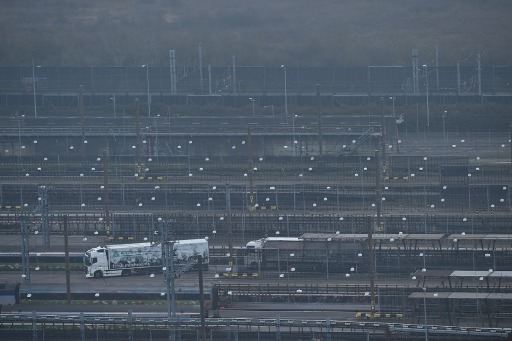 Lorries disembark a freight train at the Eurotunnel terminal at Folkestone, Southeast England, on December 31, 2020. — AFP pic