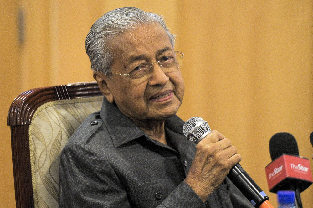 Tun Mahathir Mohamad is healthy, according to members of his family, in spite of rumours to the contrary. — Picture by Shafwan Zaidon