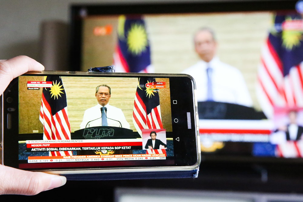 The live telecast of Prime Minister Tan Sri Muhyiddin Yassin speech about the movement control order January 11, 2020. — Picture by Choo Choy May