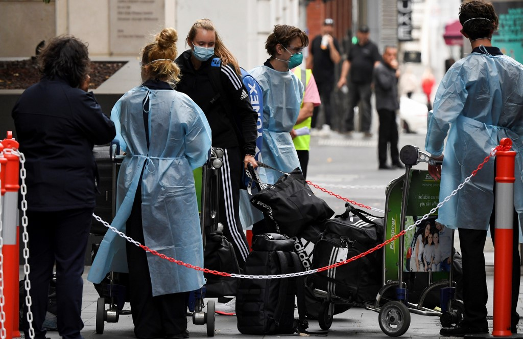 Tennis players, coaches and officials arrive at a hotel in Melbourne January 15, 2021, before quarantining for two weeks ahead of the Australian Open tennis tournament. — AFP pic