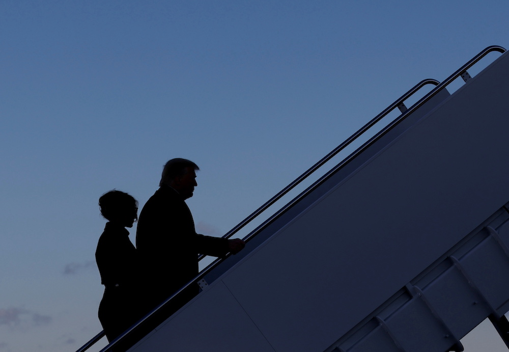 US President Donald Trump departs next to first lady Melania Trump from the Joint Base Andrews, Maryland, January 20, 2021. — Reuters pic