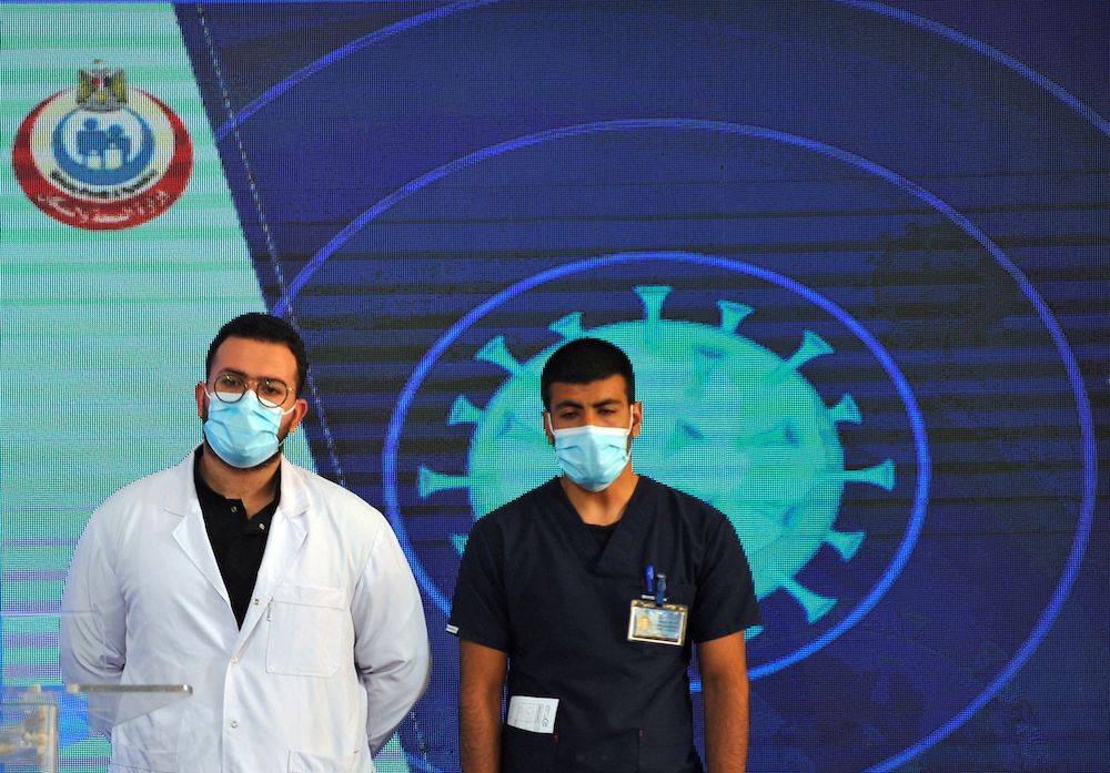 Dr Abdel Menoim Selim and nurse Ahmed Hamdan Zayed, the first two Egyptians to receive Chinese Sinopharm Covid-19 vaccine, arrive to a news conference inside a tent set up outside the Abou Khalifa hospital in Ismailia, Egypt January 24, 2021. — Reuters