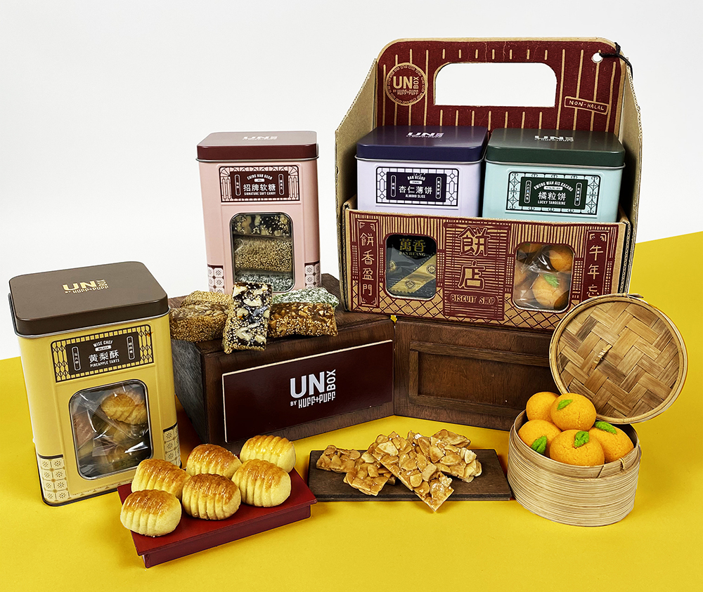 Gift the Beng Chai Hong that has snacks like pineapple tarts, tangerine cookies, soft candy and almond slices packaged in tins inspired by old school biscuit tins. — Pictures courtesy of UNBOX by Huff & Puff