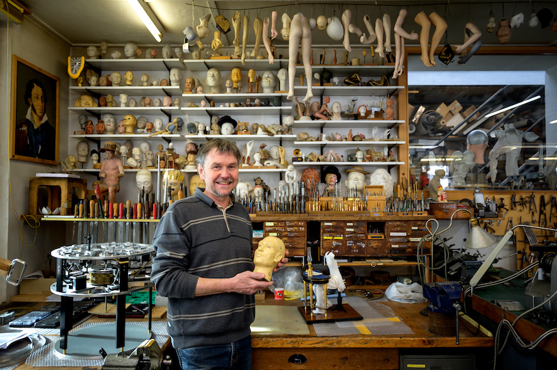 A picture taken on January 19, 2021 shows Swiss master Francois Junod posing with his tools and some heads used for the molding of parts of moving mechanical artworks, in his workshop in Sainte-Croix. — AFP pic