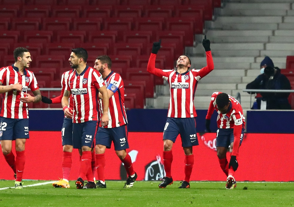 Atletico Madrid's Angel Correa celebrates with teammates after scoring the first goal against Sevilla January 13, 2021. ― Reuters pic