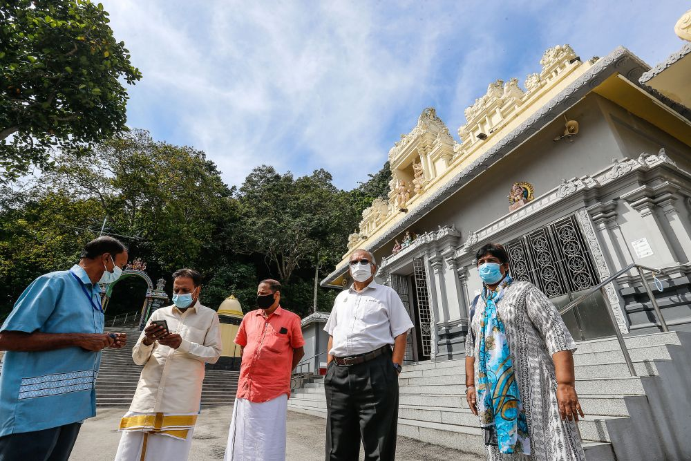 Penang Deputy Chief Minister P. Ramasamy (second from right) during a visit to the Arulmigu Balathandayuthapani Temple in George Town January 26, 2021. — Picture by Sayuti Zainudin
