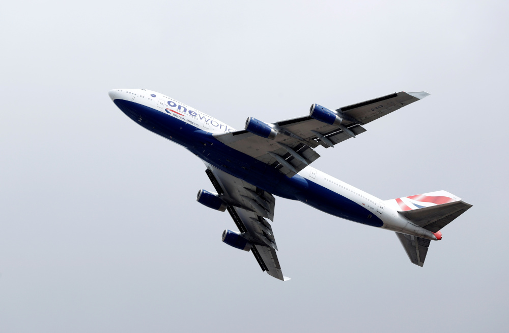 A British Airways Boeing 747 G-CIVD leaves London Heathrow airport on its final flight, the first of 31 jumbo jets to be retired early by the airline due to the coronavirus disease pandemic, in London, Britain August 18, 2020. — Reuters pi