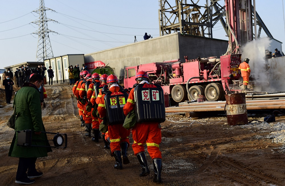 Rescuers are seen at the site where workers were trapped underground after an explosion at the gold mine under construction, in Qixia, Shandong province, China January 13, 2021. ― Handout via Reuters