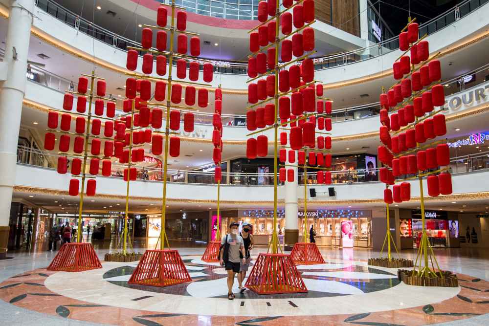 The towering decorations are lending a festive touch to the mall for Chinese New Year. — Picture by Firdaus Latif