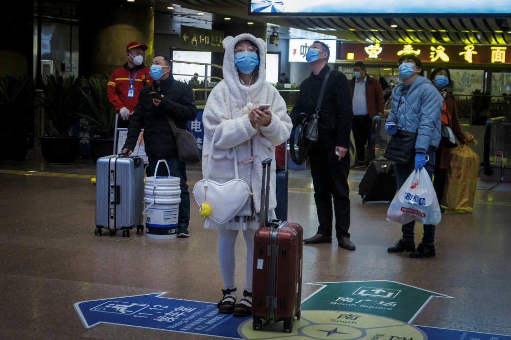 Travellers wear face masks at a train station following the outbreak of the coronavirus disease in Beijing, China, January 13, 2021. — Reuters pic