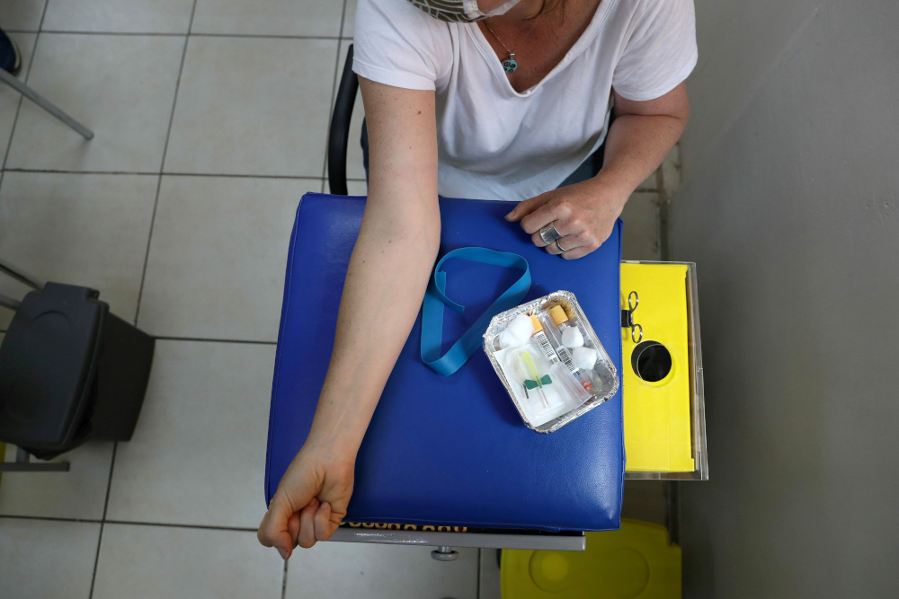 Reuters senior correspondent Aislinn Laing prepares to give a blood sample before receiving a dose of vaccine or placebo of Johnson & Johnson's Covid-19 vaccine clinical trial at Colina area, Santiago, Chile, November 20, 2020. — Reuters pic